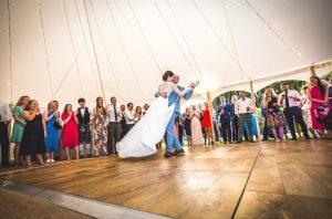 First dance in marquee for garden wedding under fairy lights