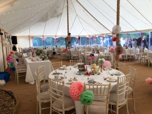 Colourful traditional marquee with fairy lights and lanterns