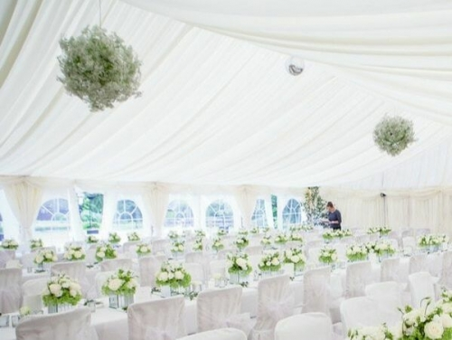 White wedding, white roses and lining with floral hanging