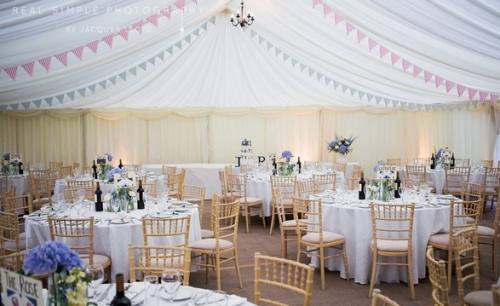 Pastel lined wedding marquee with garland