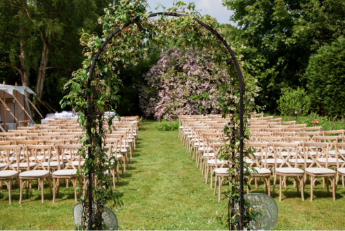 Outdoor Ceremony with floral arch