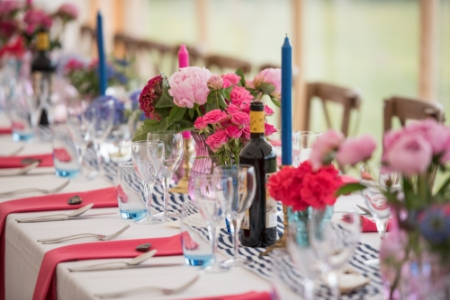 Wedding banqueting tables in blue and pink with flowers and candles